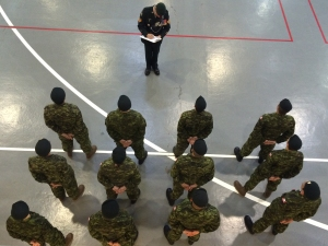 A Staff Seargant takes roll call.